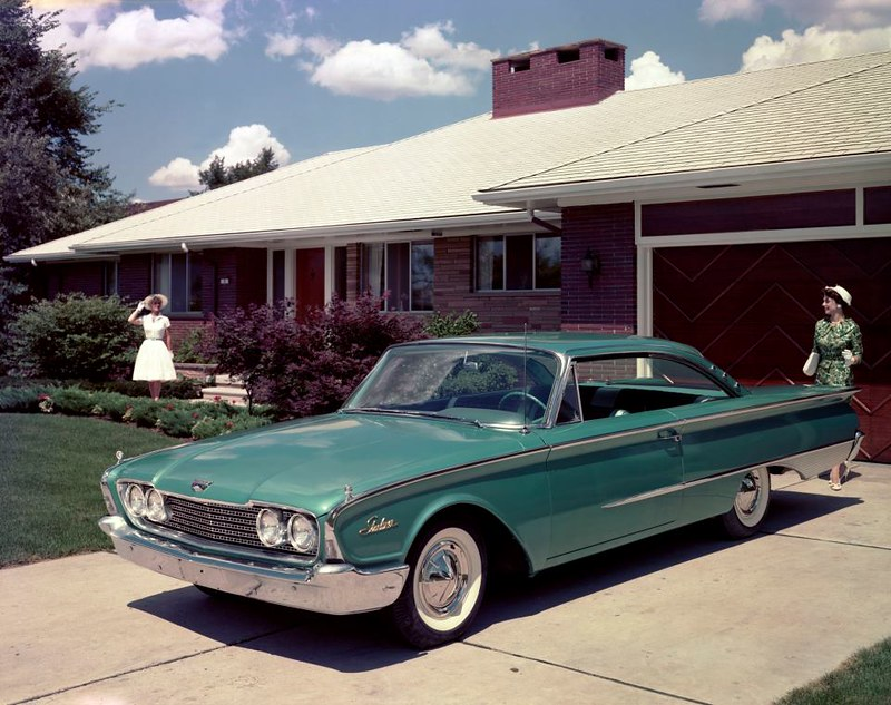Picture of a two women, house, car from 1960