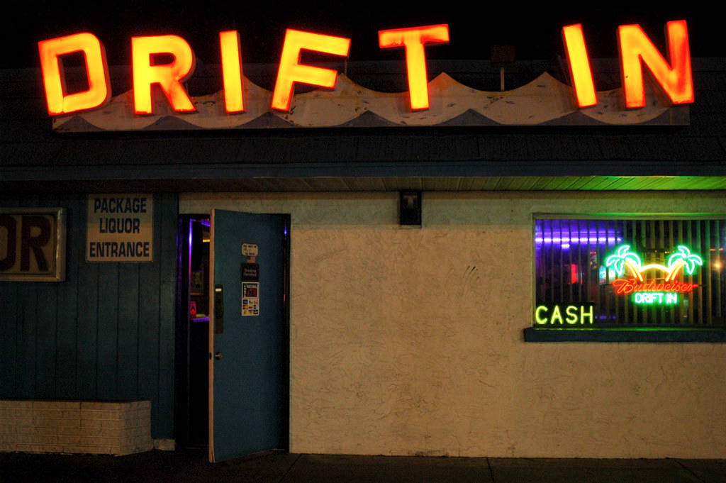 """Neon sign that says """"Drift In"""""""