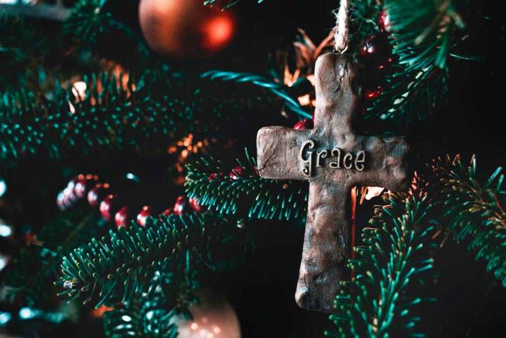 """Christmas tree ornament that says """"grace"""""""