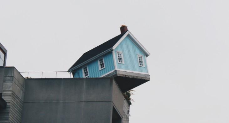 house balanced on edge of cliff