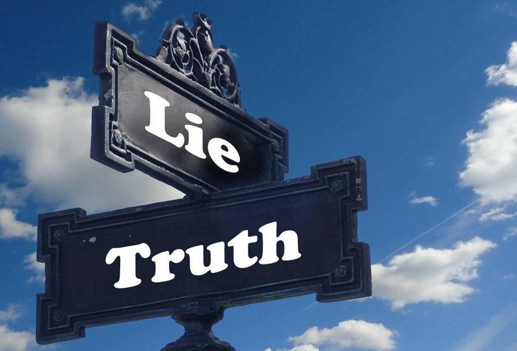 sign post with Truth and Lie