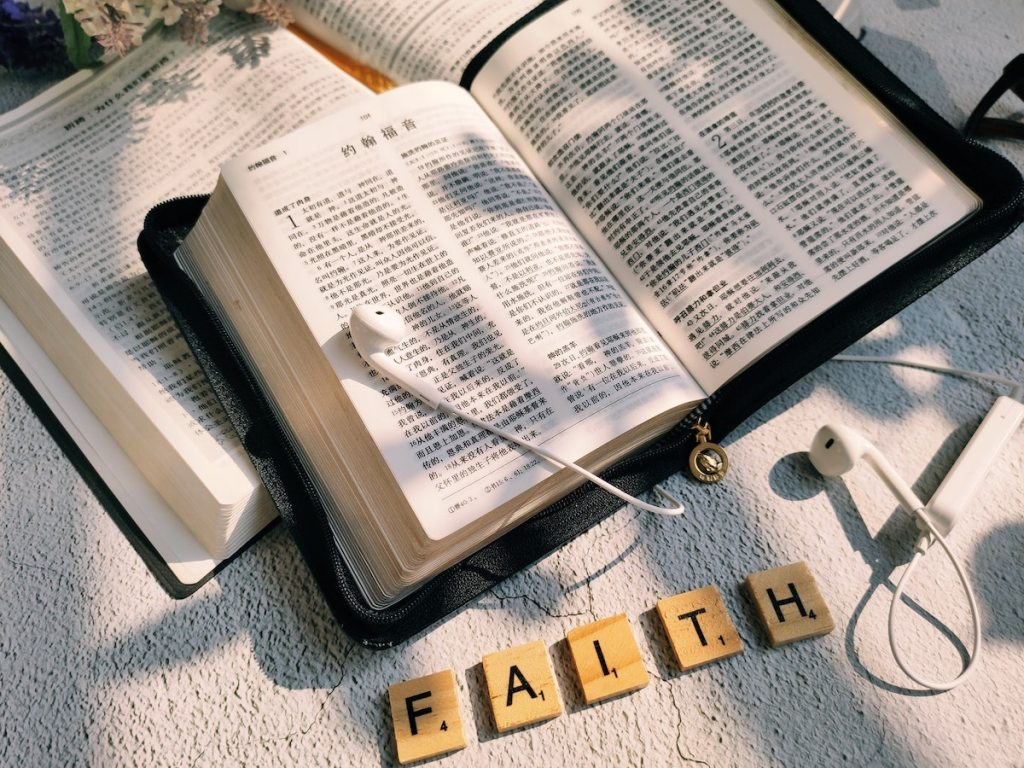 Bible and letters spelling 'faith'